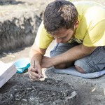 Quinnipiac student Matthew Capece collects samples from an archaeological site in Hungary.